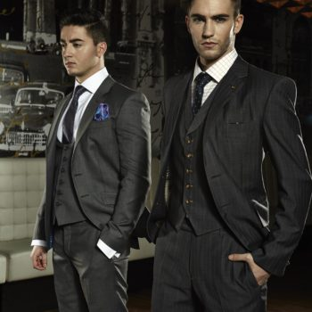 Two men modelling 100% super 120 wool grey and grey plaid suits.